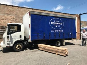 AB Hardwood Truck and a driver